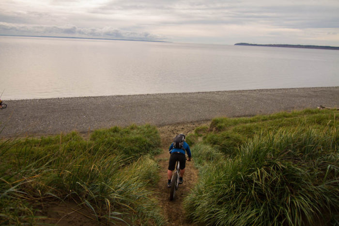 11. Work up a sweat on your mountain bike and cool off with a dip in the ocean.