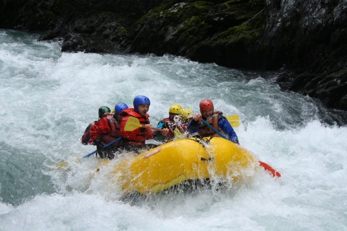 13. Get the ultimate adrenaline rush while white water rafting.