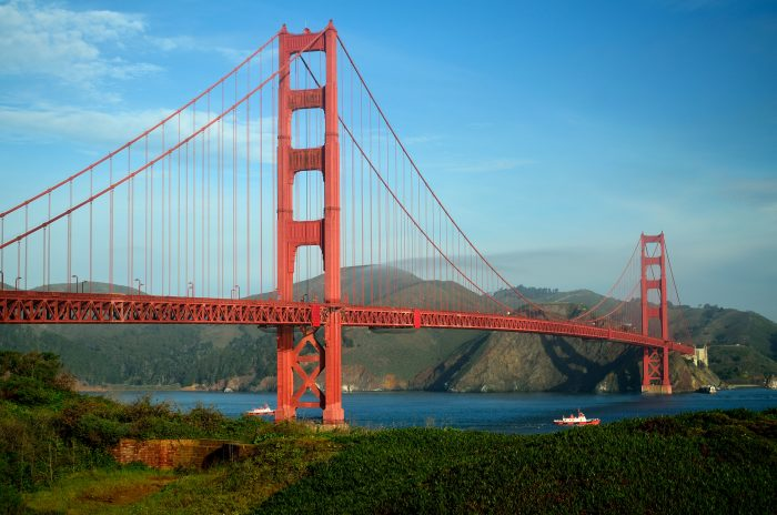 "13. The U.S. Navy wanted to paint the Golden Gate Bridge black with yellow stripes for greater visibility (could you imagine?!), but architect Irving Morrow selected the ""International Orange"" color to blend well with the natural environment. We think it was a good choice."