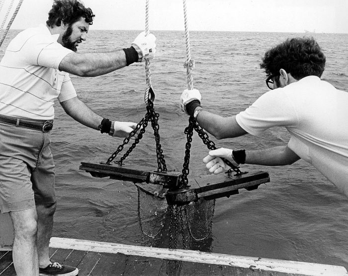 6. These scientists are lowering a trawl net into the Chesapeake Bay to capture blue crabs. Photo taken circa 1972.