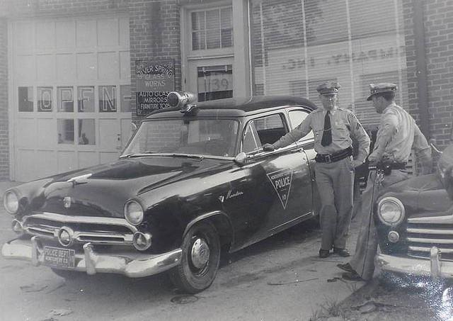 1. Two officers of the Montgomery County Police Department hanging out in Silver Spring in 1952.