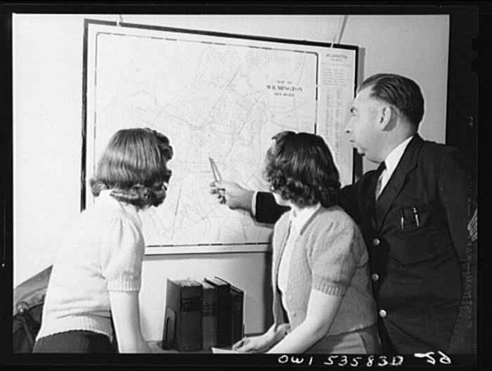 Delaware students looking at map