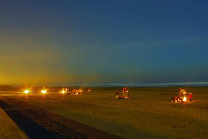 7. Bundle up, grab a bottle of wine, and head to Ocean Beach for a bonfire.