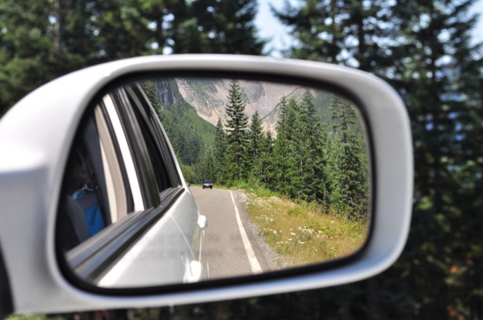 Rear_view_mirror_view_in_Mt._Rainier_National_Park,_driving_to_Longmire