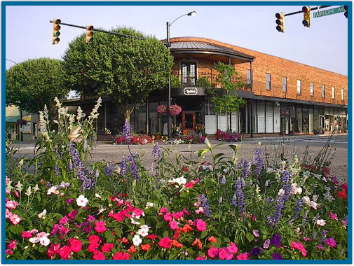 Small shops and cafes line the streets of the historic downtown district, as well as endless rows of colorful blooms.