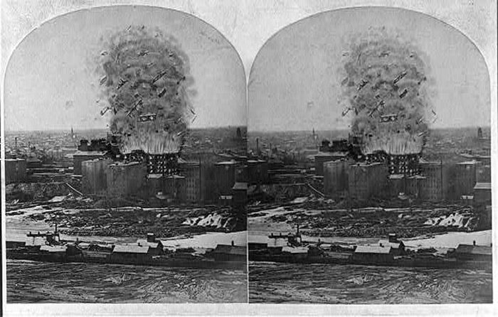 """In what would become known as the """"Great Mill Disaster,"""" the mill's fourteen man night crew and four additional workers in adjoining mills were killed when two millstones created a spark and ignited flour dust which burned rapidly causing multiple explosions."""