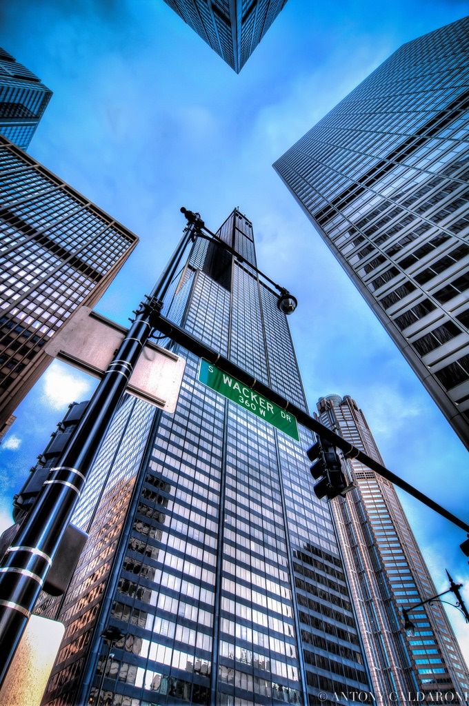 1. Head up to Willis Tower and climb over the skydeck.