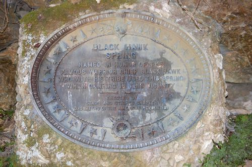 Outside of the cave is a plaque commemorating Chief Black Hawk.