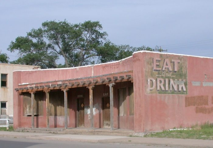 """12. You know this establishment in Carrizozo probably had a rowdy past. There are separate doors labeled """"eat"""" and """"drink"""" - looks like the bar was significantly bigger than the restaurant."""