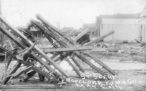 """...debris, gable-roofed buildings, downed electricity or telephone poles and water..."""