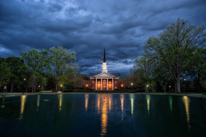 3. Daniel Chapel at Furman University at night with the lights reflecting on the water. Bring a jacket. You may find it hard to walk away...