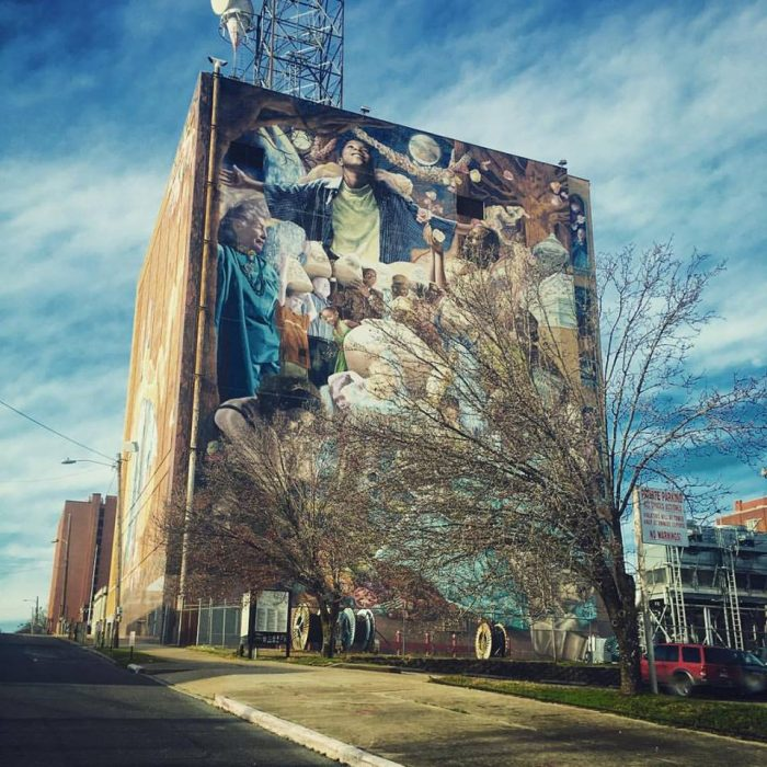 The mural takes up two walls of the AT&T building and more than 2,000 people assisted in completing the mural.