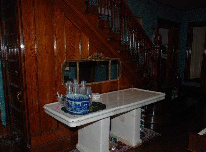 The front entryway has an embalming table that was once used in the kitchen when the house was formerly used as a funeral parlor. Can you say...CREEPY!