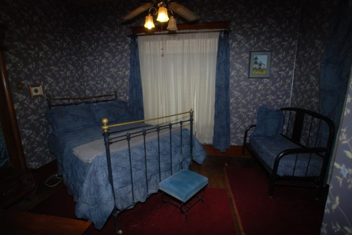 Employees and guests of Stone Lion Inn have seen apparitions in the mirror in this Parlor Suite of a man dressed in black, wearing a large Victorian hat. He is presumed to be the former owner, Mr. Houghton.