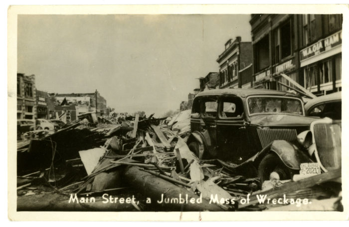 "The caption says it all, ""Main Street - A Jumbled Mess of Wreckage."""