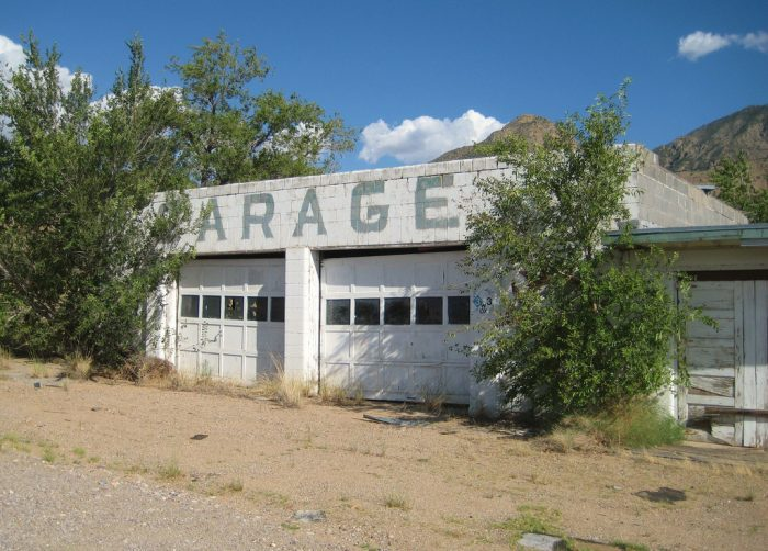 11. Organ started out as a mining camp. Today, 323 people live there. However, this garage looks pretty deserted.