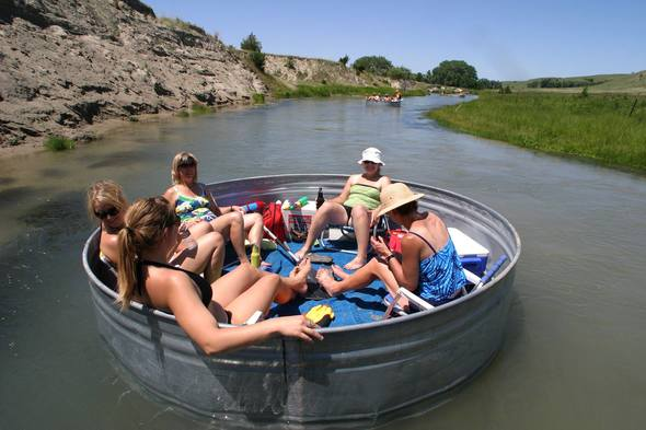 3. Go tubing or tanking on a river.