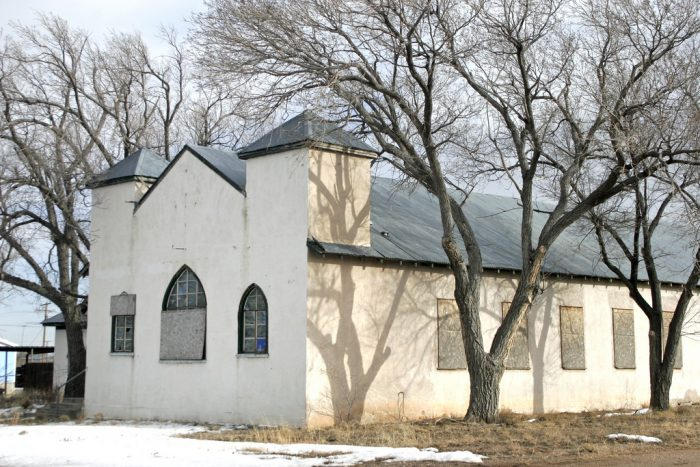 9. A shuttered up church still stands in Vaughn, New Mexico.
