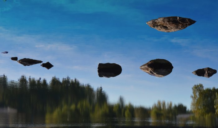 7. This shot taken at an Acton Lake is disorienting to the extreme. Are those rocks hovering? Which way is up?