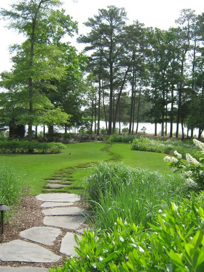 Serene stone paths spread throughout the arboretum, leading to waterfront views and other alluring terrain.