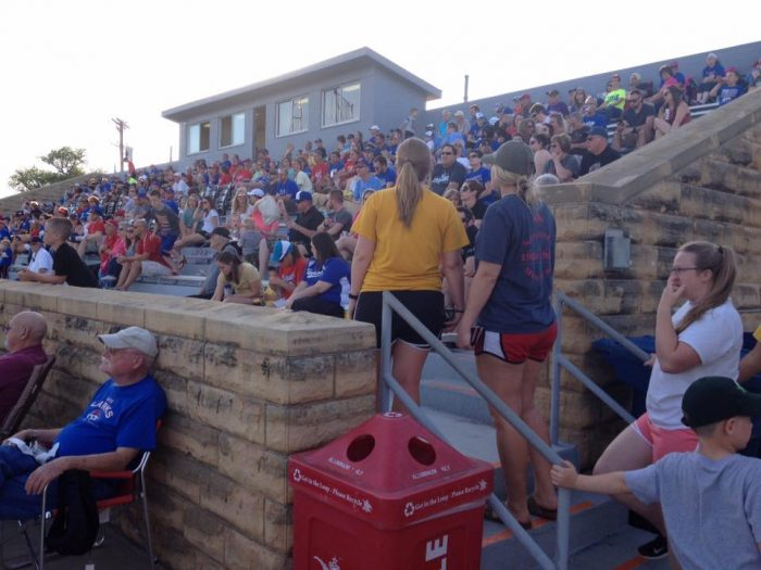 3. Cheering on the Hays Larks before heading home.