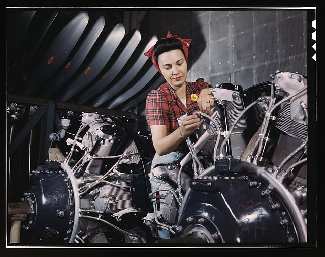 19. A woman working on an airplane motor at North American Aviation, Inc., plant in California.
