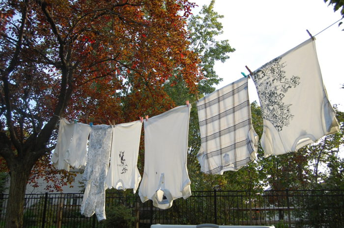 2. In Columbia, clothesline are banned, but dropping your wet laundry over a fence? No problemo.