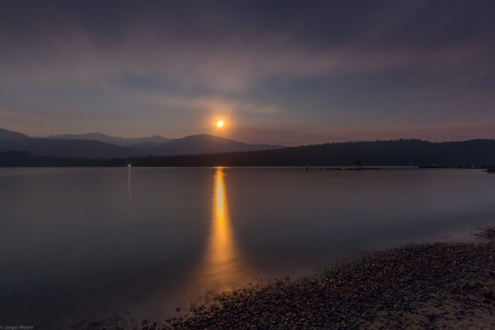 """1. Titled """"Paradox of Black Light,"""" this long-exposure shot of Priest Lake captures the moon reflecting off the water stunningly."""