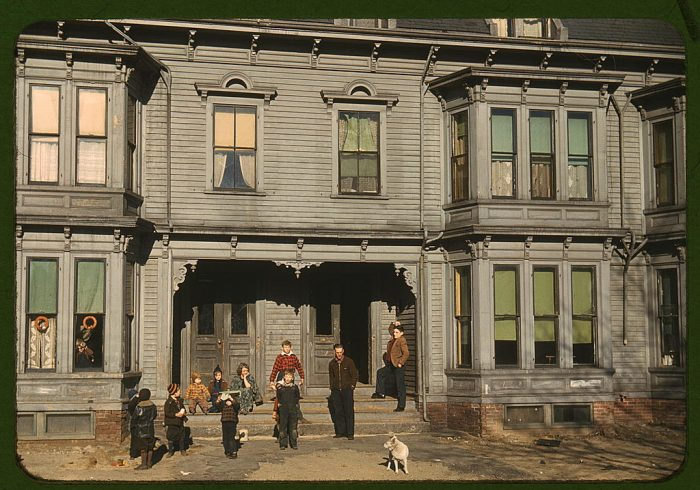 4. Children gathered outside the tenement district in Brockton.