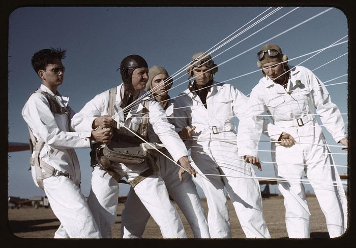 4. An instructor explaining how to operate a parachute to student pilots in Fort Worth, Texas.