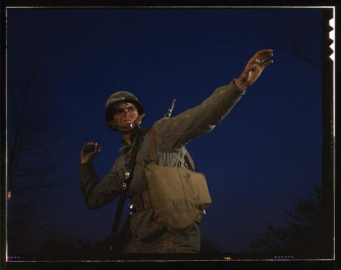 """8. This photo's description reads: """"An American pineapple, of the kind the Axis finds hard to digest, is ready to leave the hand of an infantryman in training at Fort Belvoir, Virginia. American soldiers make good grenade throwers."""""""