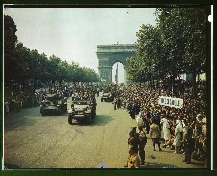 10. Crowds of French patriots line the Champs Elysees to view Allied tanks and half tracks pass through the Arc du Triomphe, after Paris was liberated on August 25, 1944.