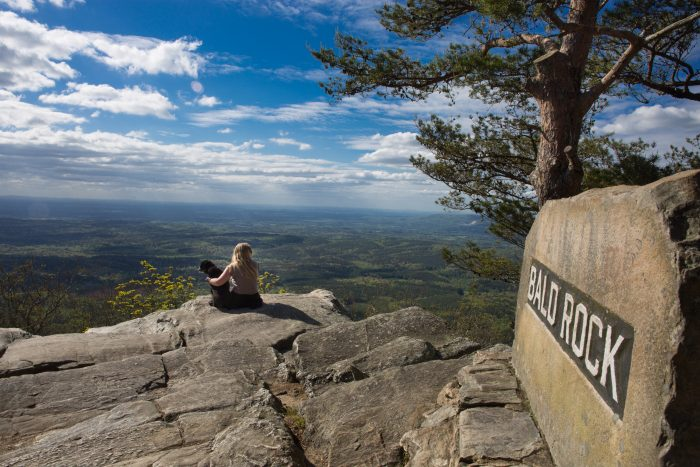 4. A girl and her dog are enjoying a gorgeous view of Alabama from Bald Rock Overlook.
