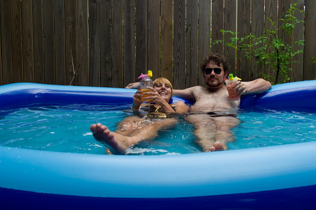 "7. Have a ""bring your own pool"" party where your friends bring over kiddie pools and serve tropical drinks."