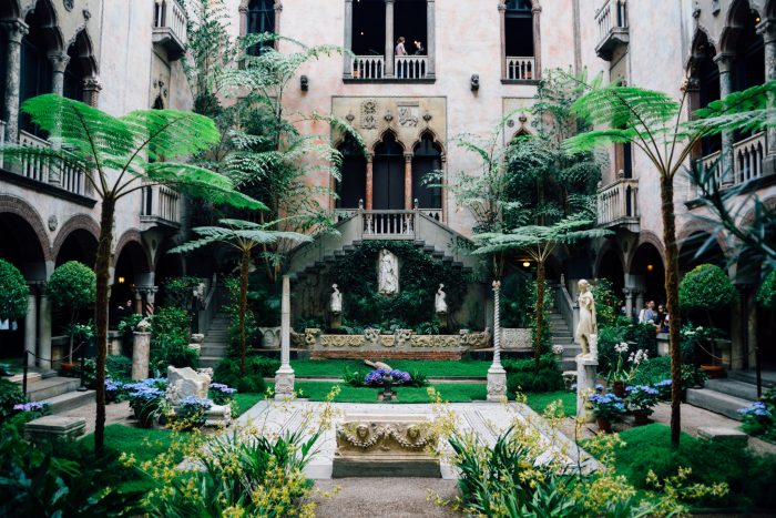 The central courtyard is framed by gorgeous stone arches and filled with fragrant blooms.