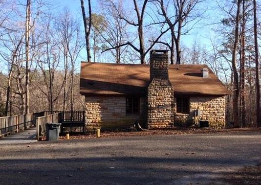 """There are also cabins available for rent. The quaint cabins are located in a wooded area on the rocky bluffs above Bear Creek and were included in Reserve America's """"Top 25 Unique Cabins"""" list."""