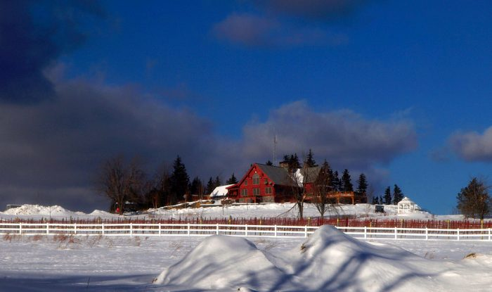 3.  The striking red against the white snow and blue sky give this home a castle-like appearance.