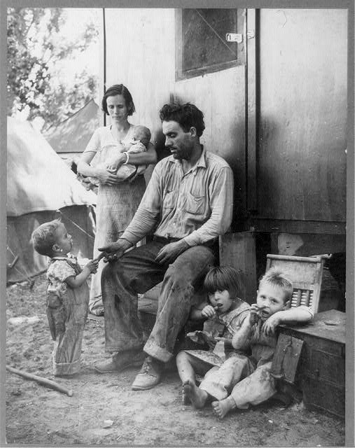 """11. The image's description is as follows: """"Texas tenant farmer in Marysville, California, migrant camp during the peach season. 1927 made seven thousand dollars in cotton. 1928 broke even. 1929 went in the hole. 1930 still deeper. 1931 lost everything. 1932 hit the road. 1935, fruit tramp in California."""""""