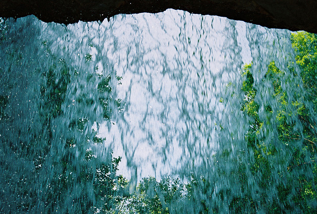 Get a peak of Cucumber Falls from behind the waterfall then run underneath the cascading water to cool down on a hot summer day.