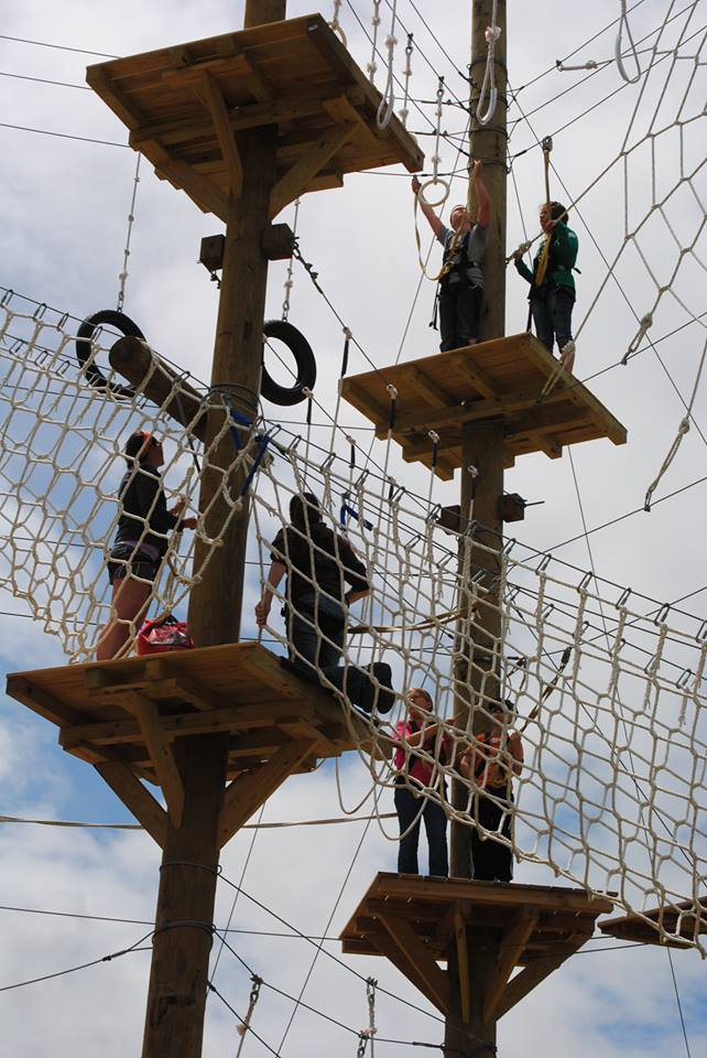 6. Challenge yourself with a ropes course and zip-lining.