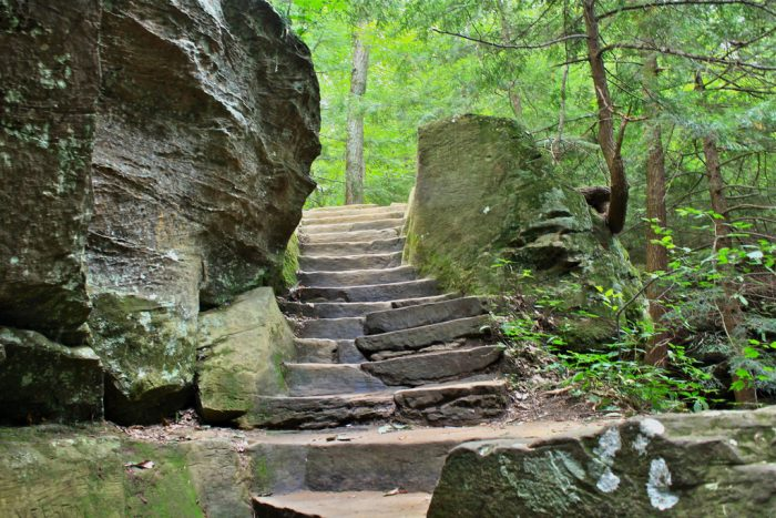 Once you get to the base of the 150-ft. cliff that the cave is connected to, you'll find steps leading the way up...