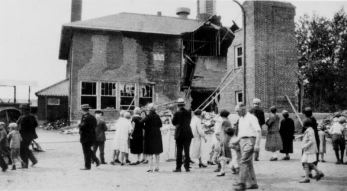 Part of the school house was destroyed in the explosion. He had secretly planted hundreds of pounds of dynamite over the course of several months.