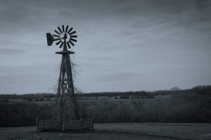 13. A moody portrait of a lonely windmill.