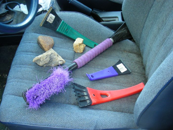 8. A variety of car-related snow removal tools.