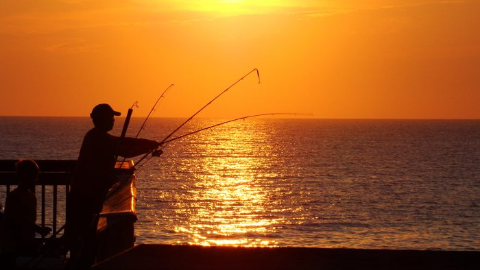 2. Try your luck with some sunset fishing
