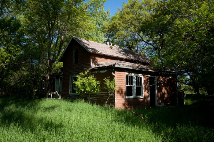 7. This overgrown abandoned house in the equally as deserted town of Sherbrooke lurks in the shadows of the trees, and who knows what lurks in the shadows inside.