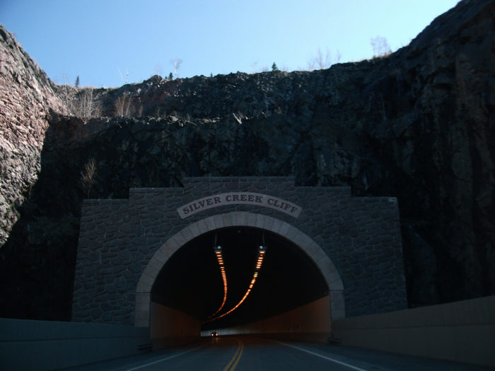 The tunnel took 3 years to complete because 500,000 cubic yards of rock had to be blown away.