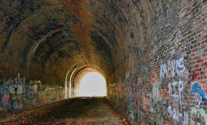 Legend has it the ghost of a man who was killed instantly by a train passing through the tunnel wanders along the track bed near the old tunnel with a lantern at night.