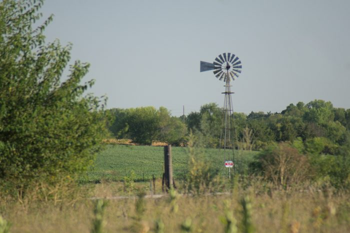 18. The depth of this picture is very striking. The windmill in the distance is watching over the land around it.
