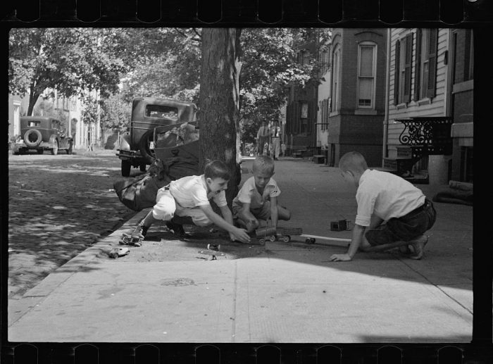 20. Young boys playing on the sidewalk in Washington, D.C.